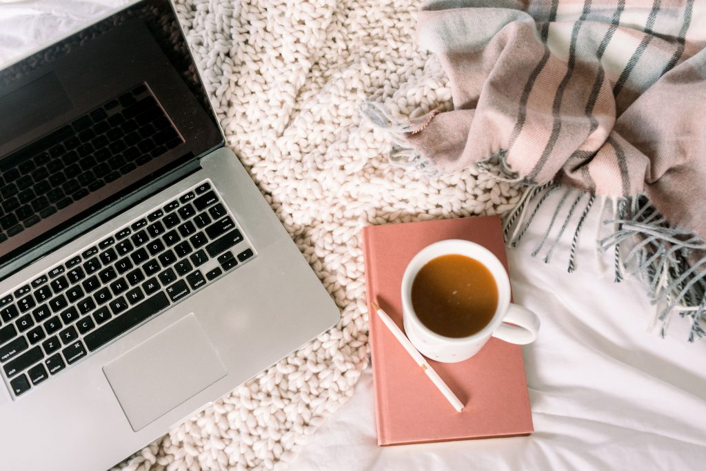 Laptop in Bed Working From Home as a Virtual Assistant with Emily Reagan PR