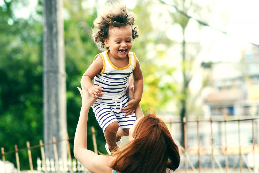 Happy toddler and mom working from home - online virtual assistant jobs with Emily Reagan PR